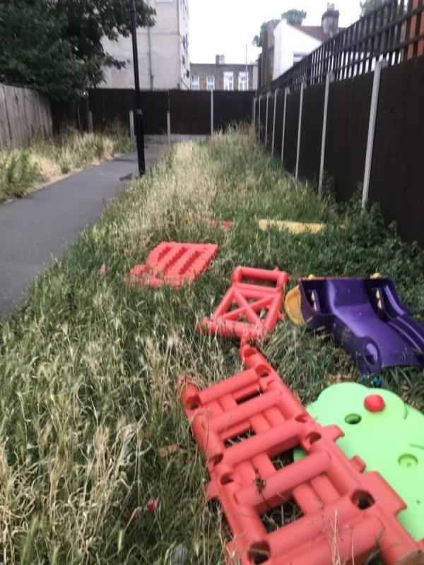 Arthur Horsley Walk. Grass overgrown catching litter for months. Reported at least 3 times without the mower appearing -34 Magpie Close, London, E7 9DE
