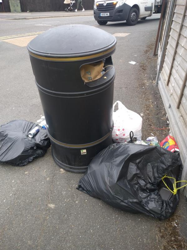 Fly tipped wast left at litter bin on junction of Basingstoke Road and Callington Road -1 Callington Road, Reading, RG2 7QQ