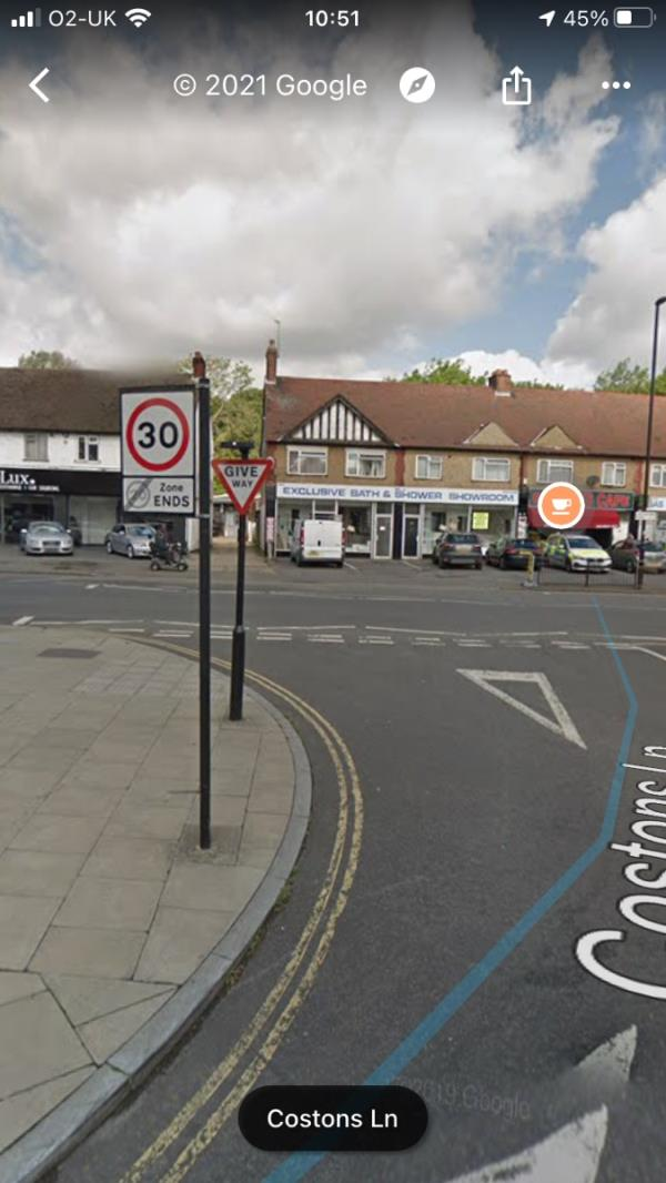 Illuminated Give Way sign is facing the wrong way and needs to have its orientation adjusted on Costons Lane junction Greenford Road ub6 opposite The Salvation Army hall Ub6 -Salvation Hall Costons Lane, Greenford, UB6 8QT