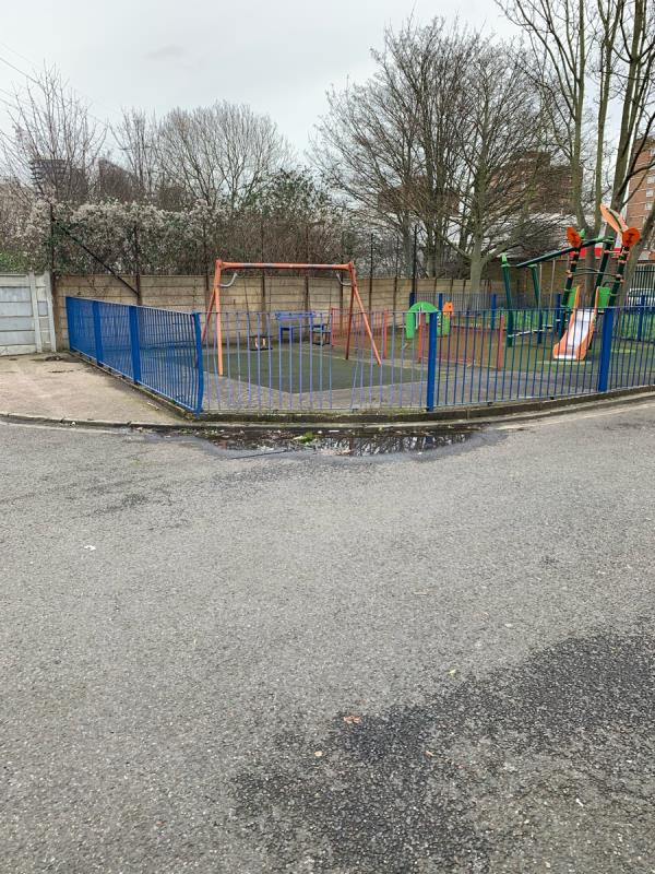 The road in front of kids playing area needs to be urgently levelled up in front of 1-15 Daines close, E12 5LQ. Due to this stagnant water kids are in extreme danger of accident and slip and trips - The roads needs to levelled up so that the water flows into the drain next to it  image 2-11 Daines Close, Manor Park, E12 5LQ