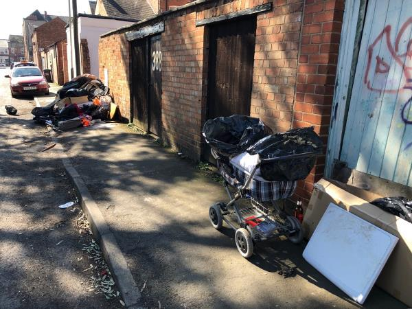 Items dumped at rear of 38B fosse road central. Items actually located on norfolk street-107 Norfolk Street, Leicester, LE3 5QL