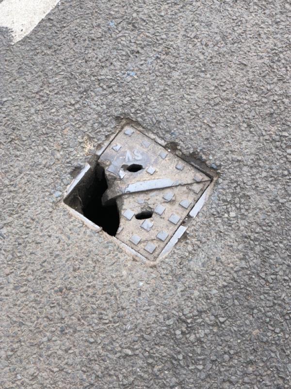 Broken manhole Eaton road by lamppost 18-1 Berkley Drive, Handbridge, CH4 7EL