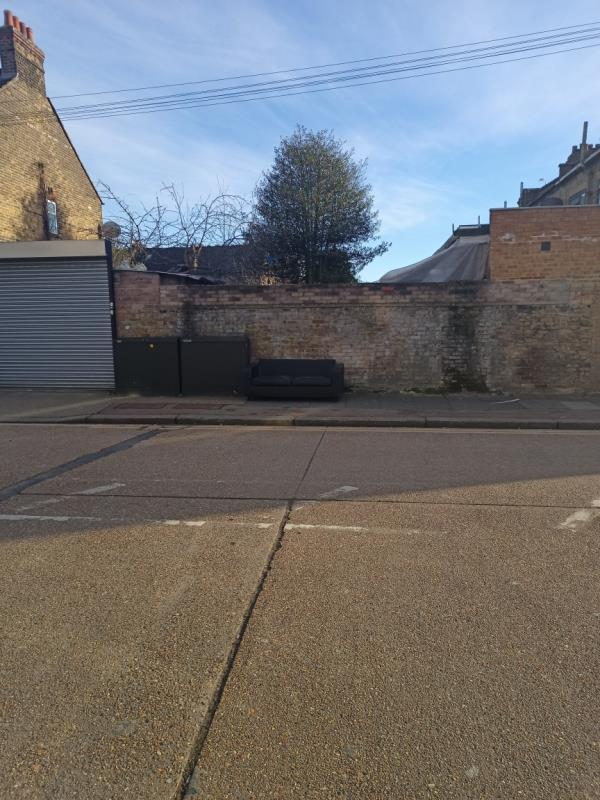 Old couch dumped -105 Burges Road, East Ham, E6 2BL