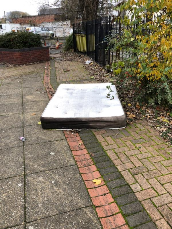 Lots of discarded rubbish including this mattress. -Regent Buildings Hall Street, Wolverhampton, WV14 0EA