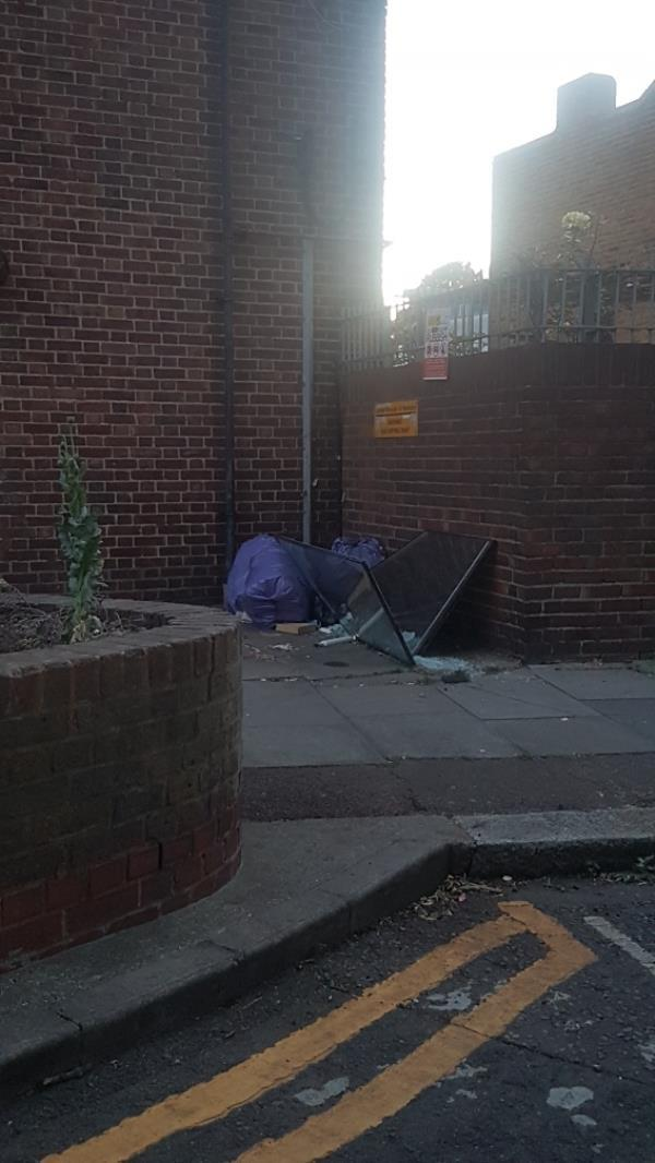 mirror dumped with other rubbish-128 Plaistow Road, London, E15 3HL