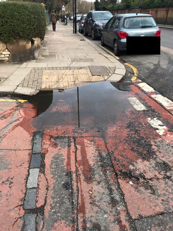 This puddle is here all the time , it is dry and still here causing children to go into the road to avoid it-312 St Ann's Road, London, N15 3