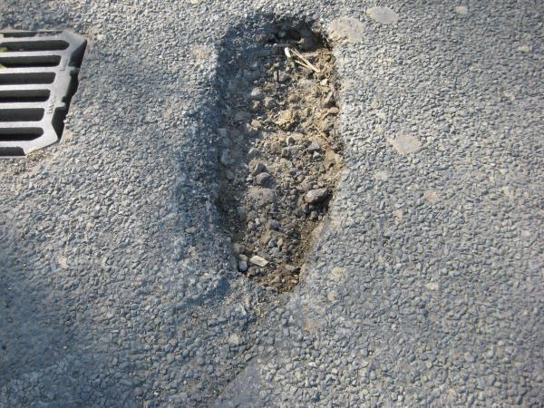 Pothole on nearside on Christs Hospital Road about 300 metres going down the road after crossing the railway line towards Itchingfield-Christs Hospital Road, Horsham, RH13 0BD