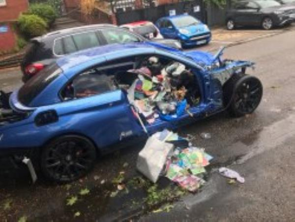 This car has been parked like this for over a month now with a lot of rubbish now placed in it too. It is in the car park behind Falmouth close on Taunton road the entrance is opposite Sainsbury's car park entrance. Reported Via Fix My Street-Falmouth close