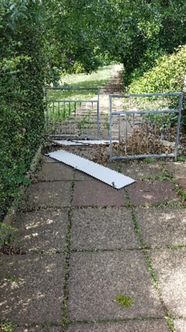 Flytipping across path at entrance to Lousehill Copse-56 Brockley Close, Reading, RG30 4YP