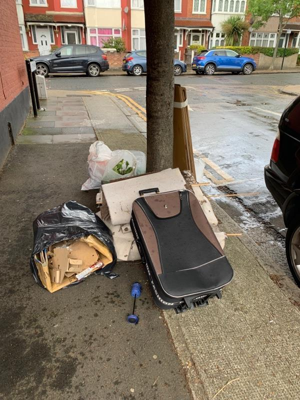 More crap dumped by antisocial scumbags next to tree near 2 Langdon Road E6 close to junction of Park Avenue E6-136 Folkestone Rd, East Ham, London E6 6AY, UK