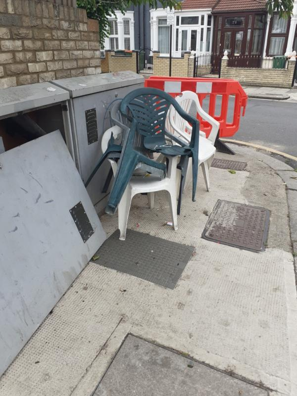 5 plastic garden chairs left on pavement at junction between Sibley Grove and East Avenue -79 East Avenue, Manor Park, E12 6SD