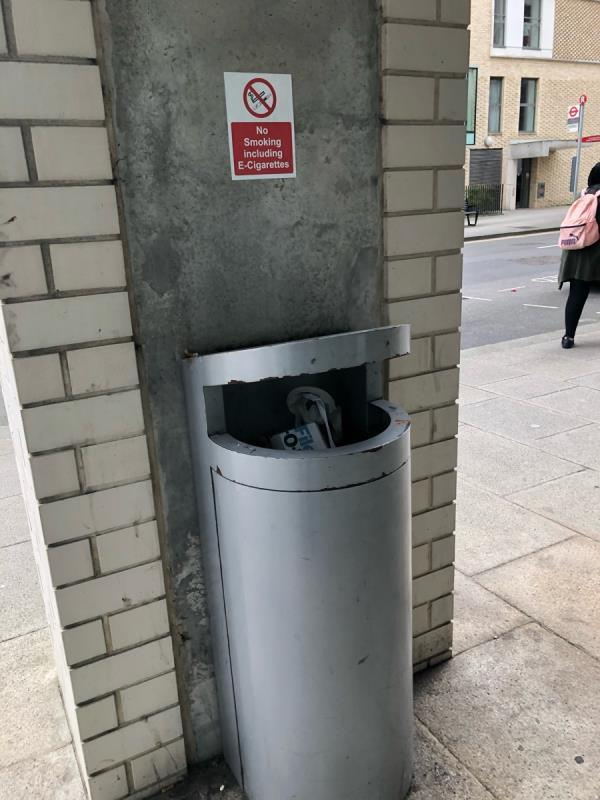 Bin full outside pharmacy next to doctors on liberty bridge road.-42 Liberty Bridge Rd, East Village, London E20 1AS, UK