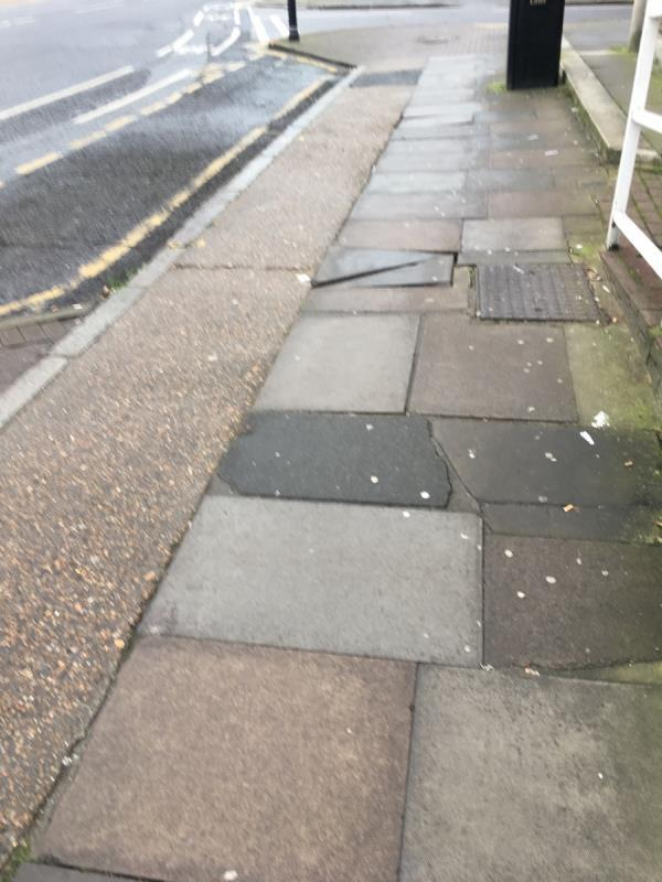 Dangerous paving outside Heritage Hub corner of Romford / Tavistock roads-115 Romford Road, London, E15 4LY