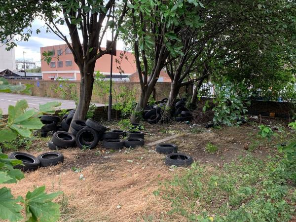 Many car tyres fly tipped-Lund Point Carpenters Road, London, E15 2JR