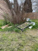 A wooden bed and various other objects appeared under the tree overnight 9/10th April.  image 1-43 Barnwood Close, Reading, RG30 1BY