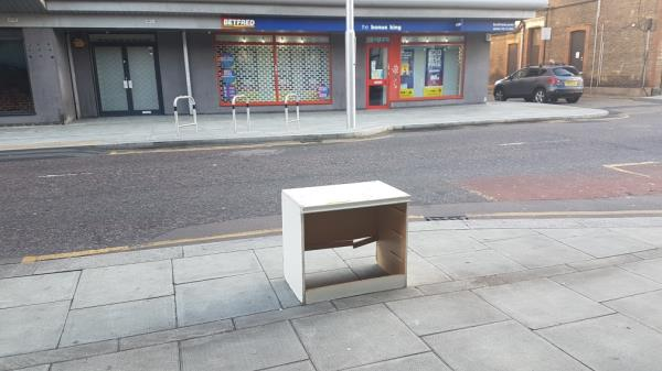 A single item of furniture left on the pavement. -18 Carolina Cl, London E15 1JR, UK