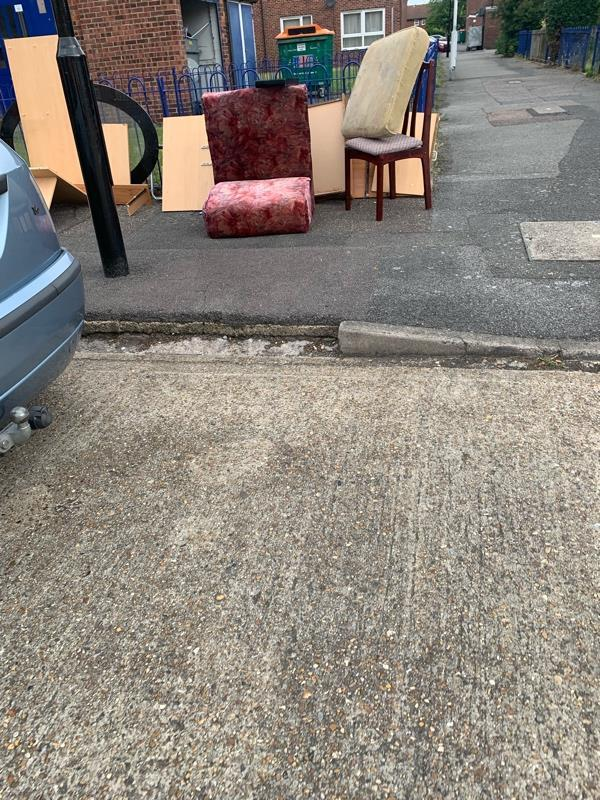 Loads of wood and parts of a settee dumped on pavement in chenappa close needs removing ASAP please -22 Chenappa Cl, London E13 8DZ, UK