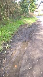 Water running from a drain down Broadwater Lane causing deep edge ruts-2 Whites Cottages Broadwater Lane, Copsale, RH13 6QL