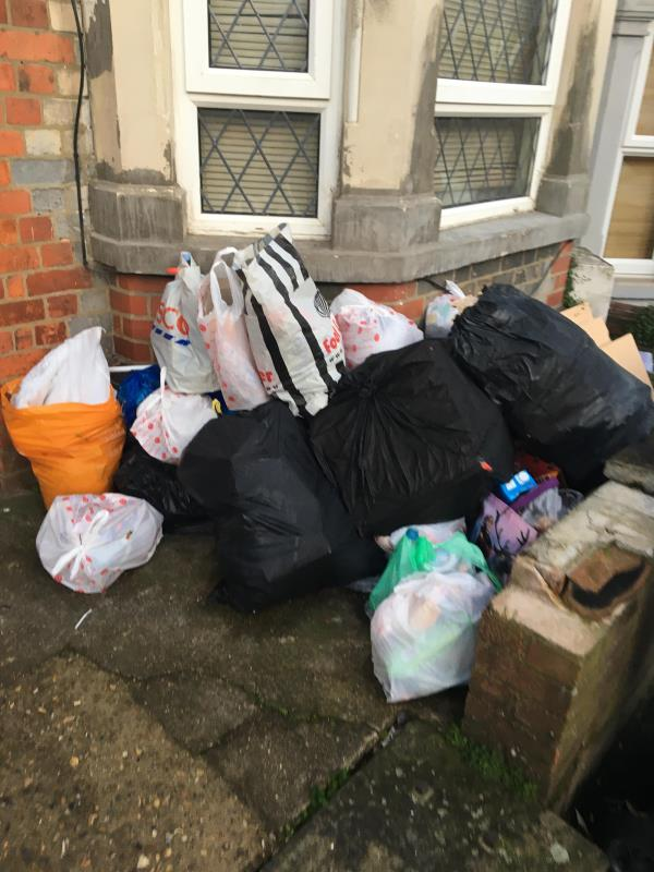 Again a large pile of rubbish bags accumulating at nbr 38. This is caused by this house only having 1 (grey) bin, no recycling bin, and probably about 8 adults living there.-38 Franklin Street, Reading, RG1 7YE