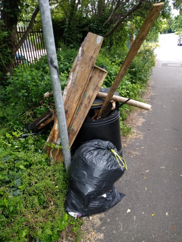 Fly tipped wast including wood at litter bin in Gillette Way -2 Gillette Way, Reading, RG2 0LR