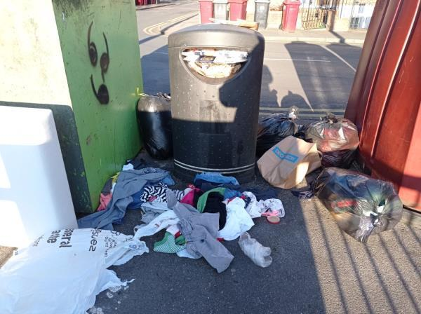 Bags of domestic rubbish and clothes. Also piece of furniture.-3 Baker Street, Reading, RG1 7LJ