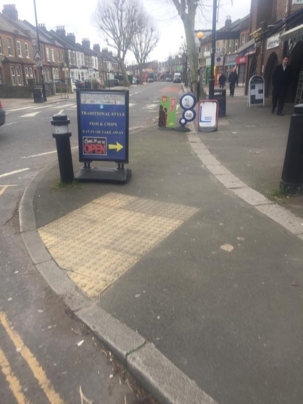 An increasing number of boards cluttering the public footpath. Please get them removed -2 Northfield Avenue, London, W13 9RJ