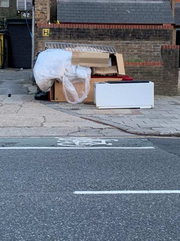 Loads of rubbish on pavement obstruction. -242 Romford Road, London, E7 9HZ