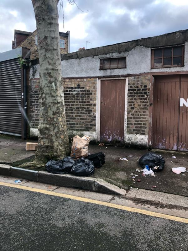 Household bin bags fly tipped-89 Rosebery Avenue, London, E12 6PY