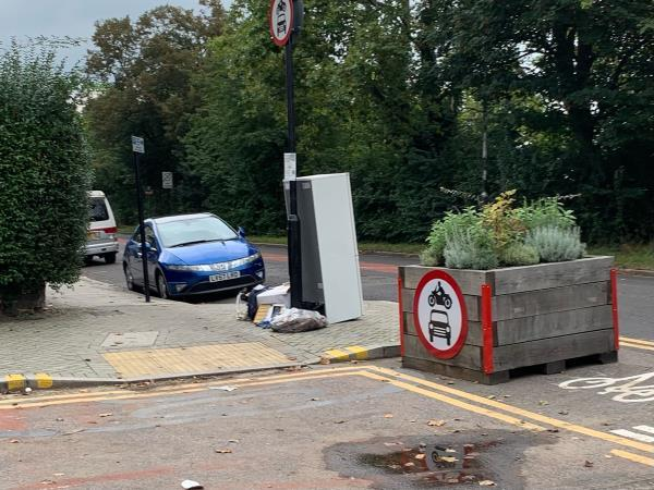 Fridge and pile of household items dumped next to planters on corner of Woodford/Forest Roads.-101 Woodford Rd, London E7 0DL, UK