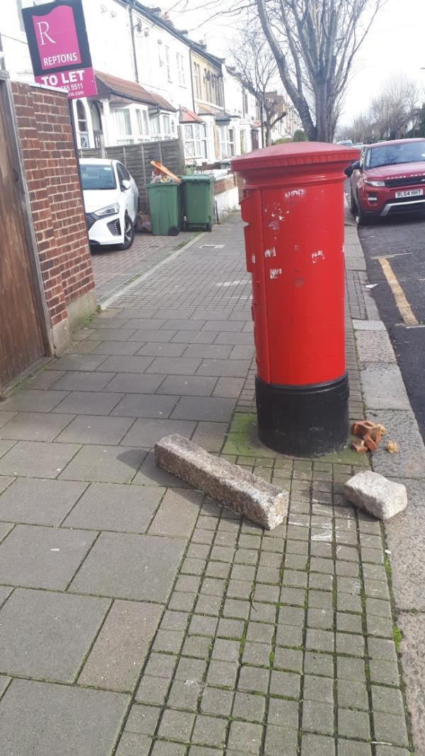 Granite/concrete blocks on footway of Chobham Road, next to post box, opposite The Eagle-159 Chobham Road, London, E15 1LZ
