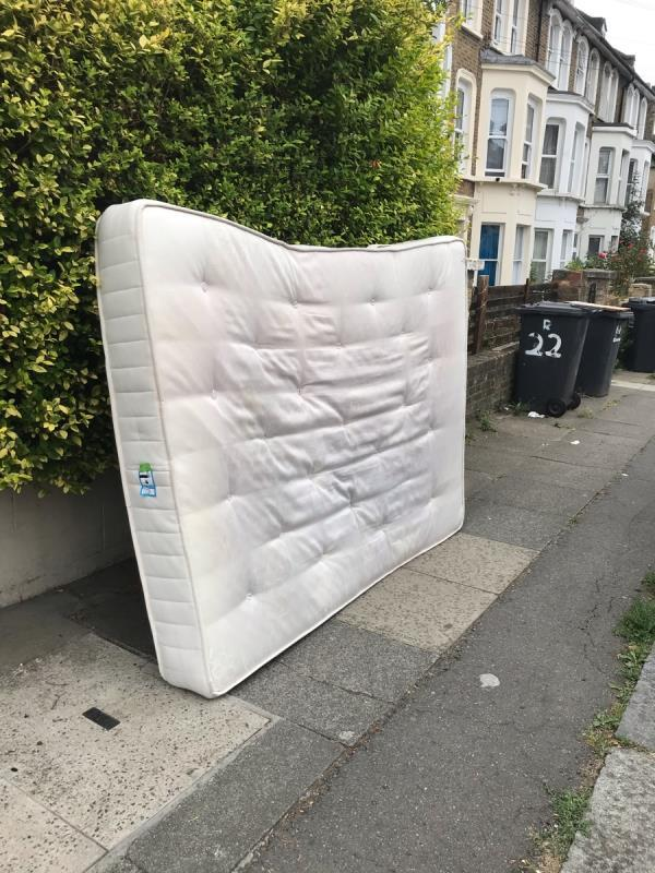 Double mattress abandoned in the middle of the street-20 Ravensbourne Road, London, SE6 4UX