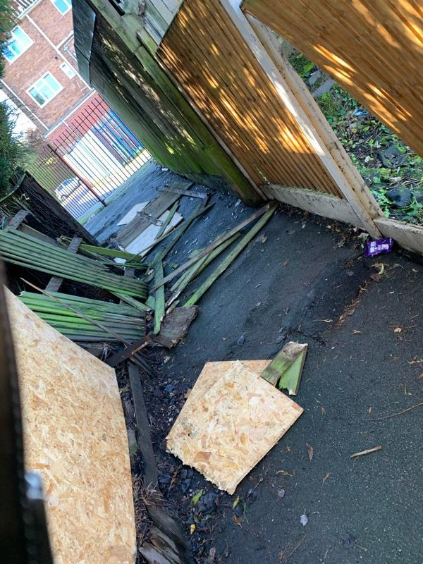 Broken fence panels damaged by kids its a trip hazards bricks on floor too in the alley way at end of pointon close -19 Pointon Close, Wolverhampton, WV14 9XE
