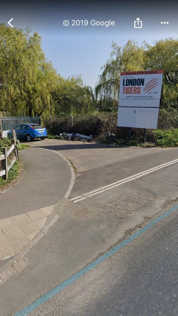 Huge fly tip is located at the entrance gates to London Tigers Playing Fields on Eastbound A40 Western Avenue past Dunelm mill-Western Avenue, London, UB6 8XG