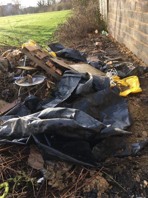 Property in Honey end lane had new wall built and has dumped rubbish from the build behind their wall Prospect park. Been several weeks now.-36 Granville Road, Reading, RG30 4EQ