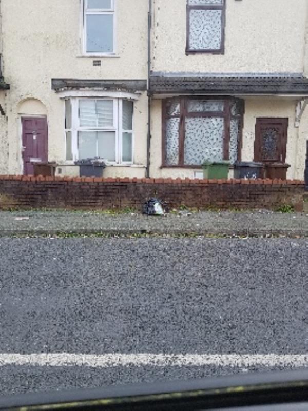 Litter and fly tipped rubbish outside 27 and 28 Knox rd. The whole Strees needs cleaning.-57 Knox Road, Wolverhampton, WV2 3EG