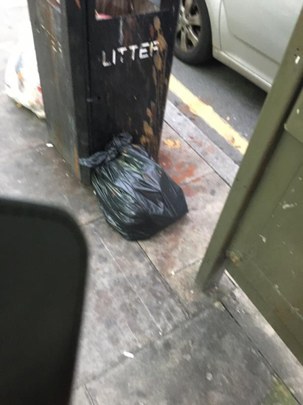 Rubbish bin over flowing -63a Plashet Grove, London, E6 1AD