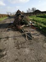 Large amount of tree cuttings and other rubbish-Meadow Farm Newells Lane, Chichester, PO18 8PH