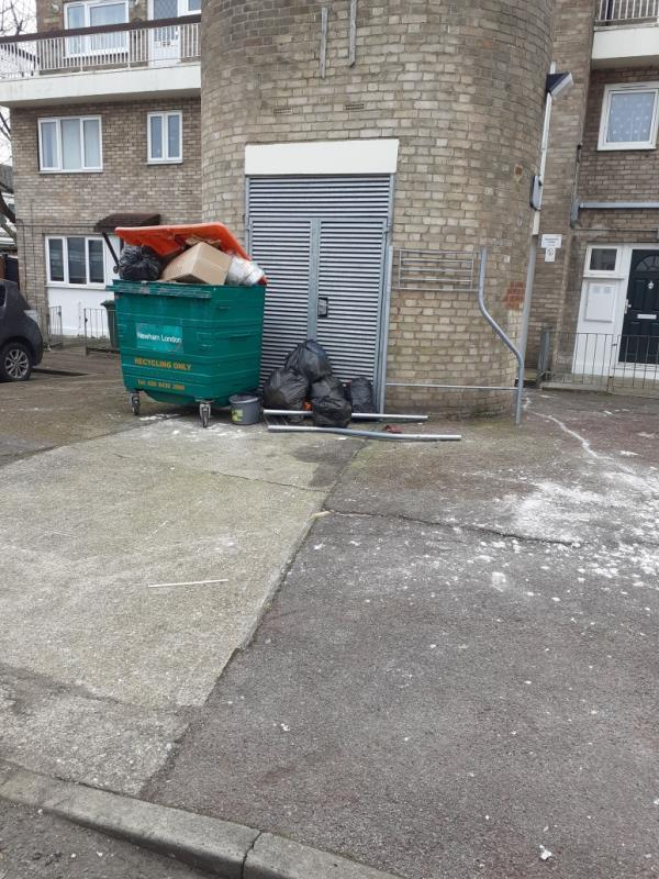 Overflow recycle bins, filled with domestic waste from around the households-8 Gawsworth Close, London, E15 1RT