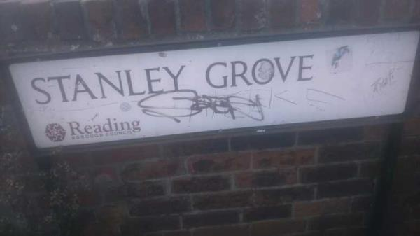 graffiti on the street nameplate   -10 George Street, Reading, RG1 7NT