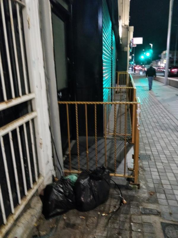Dumped black bags of rubbish on the pavement beside 3a Leytonstone Road E15-3a Leytonstone Road, London, E15 1JA