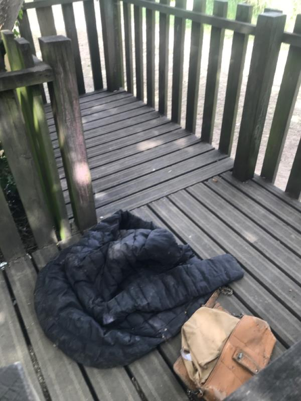 Filthy mans jacket and dirty old handbag dumped on kids tree house within forest lane park. Area being used by drug addicts FAO enforcement also-77 Magpie Close, London, E7 9DE