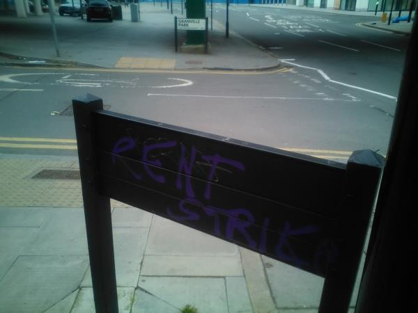 Graffiti is on the reverse side of the streetsign for 'Granville Park'-318 Lewisham Road, Lewisham, SE13 7DU