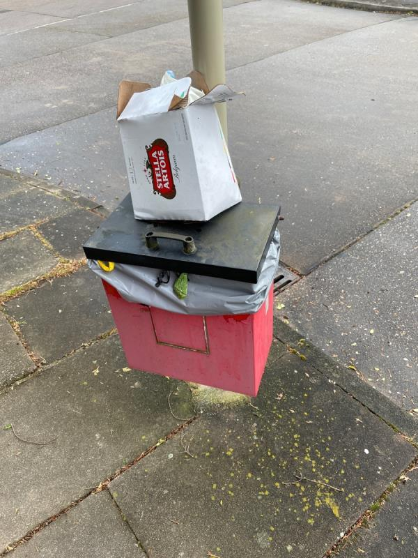 Some ones dumped a load of rubbish on the dog poo bin (which is also full)-67 Hylion Road, Leicester, LE2 6JE