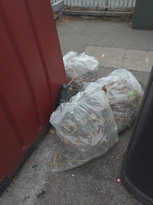 fly tipping because of bottle bank!!-44 Howard Street, Reading, RG1 7LJ