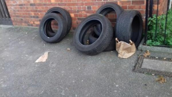 6 tyres dumped at Surrey Street opposite the construction site -2 Surrey St, Plaistow, London E13 8RJ, UK