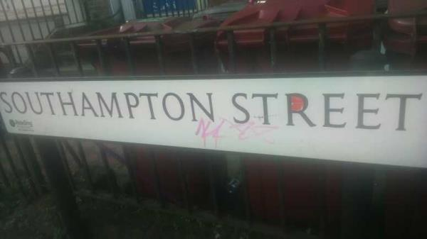 graffiti on the street nameplate -84 Southampton Street, Reading, RG1 2QR