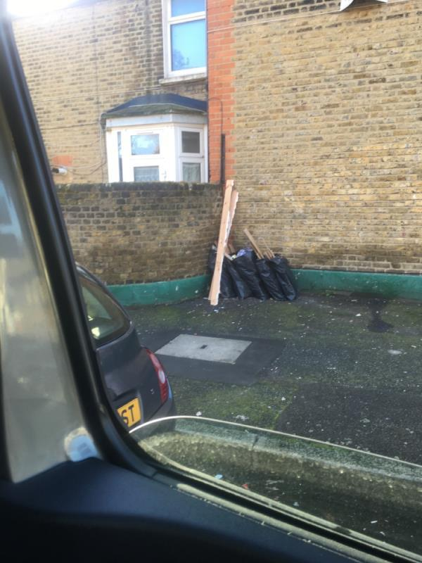 Laminate flooring and bags Builder rubbish Clacton Road and boundary road junction -88 Boundary Road, London, E13 9QG