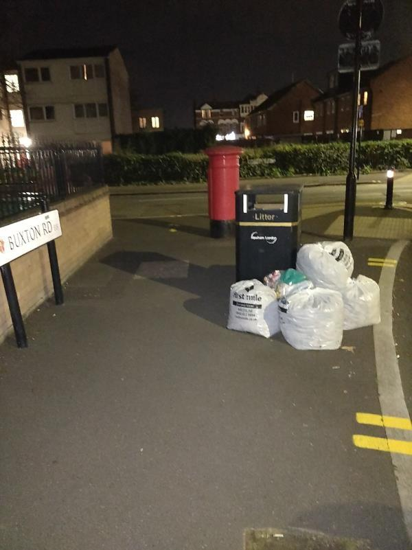 Uncollected bags of rubbish on the pavement at the corner of Buxton and Ash Road E15-100 Buxton Road, London, E15 1QX