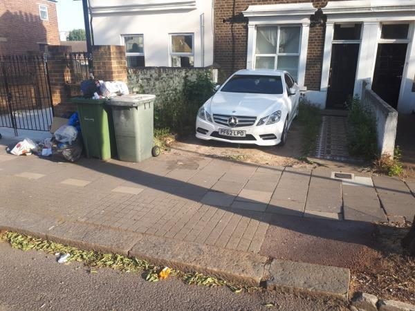 Rubbish fly tipped on the footway in front of 67 Chobham Road E15 1LX, overflow from the wheelie bins for 67 Chobham Road?  Wheelie bins for 67 Chobham Road permanently kept on the footway, although there is room in the front garden to store them.  The front garden of 67 Chobham Road is used as a driveway, however it is illegal to drive a car across the footway without a vehicle crossover and dropped kerb, which has not been provided (see https://www.newham.gov.uk/homepage/111/dropped-kerbs ).-67 Chobham Road, London, E15 1LX