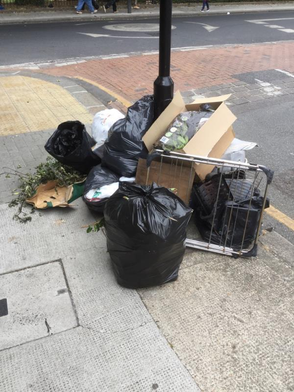 Large fly tip of various waste at the junction of plashet grove  image 1-24 Cowper Avenue, London, E6 1BJ